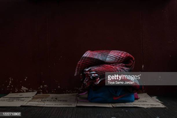 Blankets lie on cardboard on a sidewalk to be used as a makeshift bed in the Buenavista neighborhood on June 20 2020 in Mexico City Mexico Nicky...