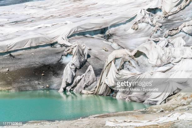 blankets protecting rhone glacier, valais, switzerland - gletscher stock-fotos und bilder