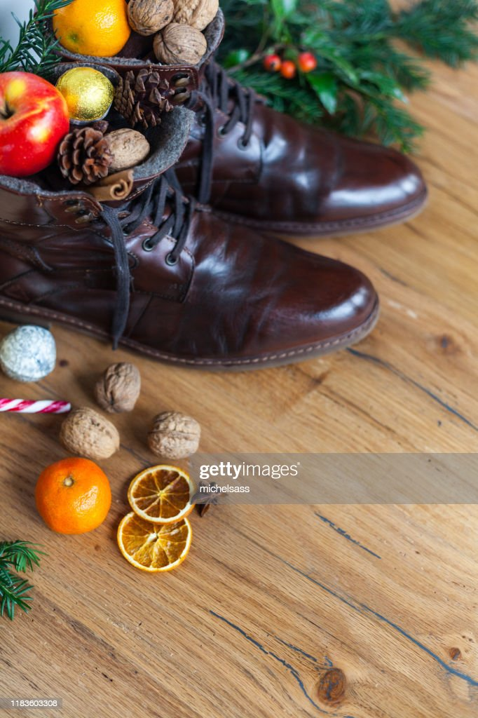 Blankly cleaned boots with sweets for st nicholas day, santa nicholas day : Stock Photo