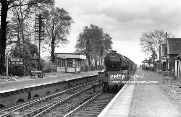 Blankney and Metheringham station on the GNGE Joint Railway line between Spalding and Lincoln with an approaching Gresley V2 No 60858 with a two...