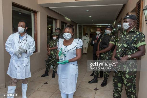 Blantyre District Health Office Medical Staff and armed policemen wear face masks to as a preventive measure against the spread of the COVID-19...