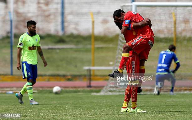 Blas Lopez of Sport Huancayo celebrates with his teammate after scoring the second goal of his team against Sporting Cristal during a match between...