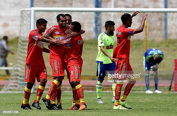 Blas Lopez of Sport Huancayo celebrates with his teammates after scoring the second goal of his team against Sporting Cristal during a match between...