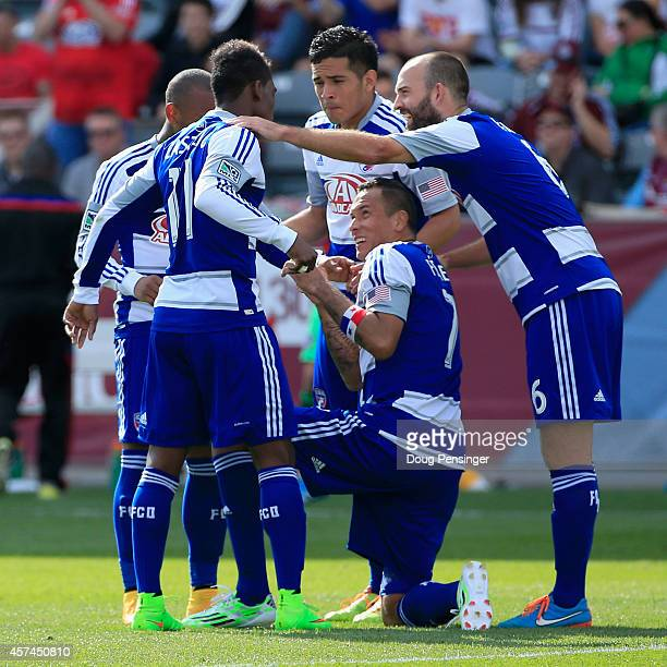 Blas Perez of FC Dallas celebrates his goal on a penalty kick in the 56th minute against the Colorado Rapids with his teammates at Dick's Sporting...