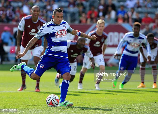 Blas Perez of FC Dallas scores a goal against goalkeeper Clint Irwin of Colorado Rapids on a penalty kick in the 56th minute as Marvell Wynne of...