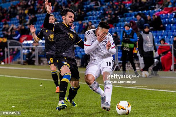 Blas Riveros of Basel battles for the ball with Praxitelis Vouros of Apoel during the UEFA Europa League round of 32 second leg match between FC...
