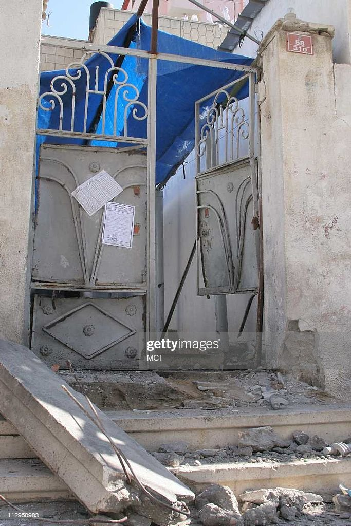 Blast damage to the door of a Gaza City cultural center hit by a