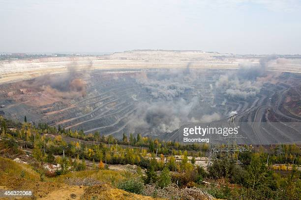 Blast debris from a detonation fills the air above the open pit of the Stoilensky GOK iron ore mine and processing plant operated by OAO Novolipetsk...
