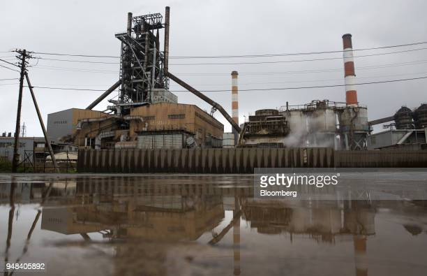 A blast furnace is reflected in water at the Nippon Steel Sumitomo Metal Corp plant in Kashima Ibaraki Japan on Wednesday April 18 2018...