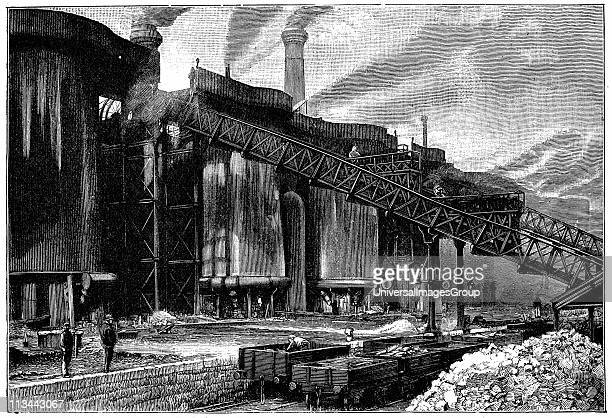 Blast furnaces Barrow Haematite Iron and Steel Company Barrow in Furness Lancashire Charge being taken to top of furnace on railway In foreground are...