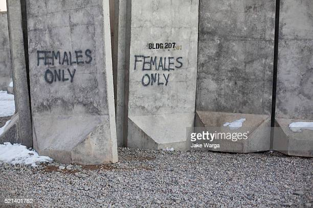 blast walls, females only housing, army base, afghanistan - jake warga stock pictures, royalty-free photos & images