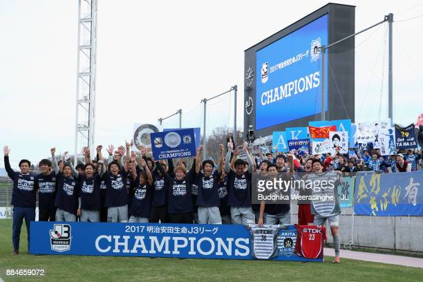 Blaublitz Akita players celebate the J3 Champions with supporters after the JLeague J3 match between Gainare Tottori and Blaublitz Akita at Torigin...