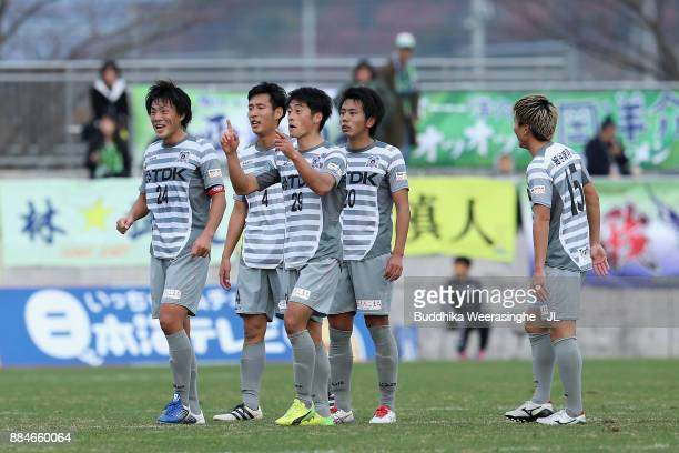 Blaublitz Akita players check the result of the game of Azul Claro Numazu and Tochigi SC at the final whistle of the JLeague J3 match between Gainare...