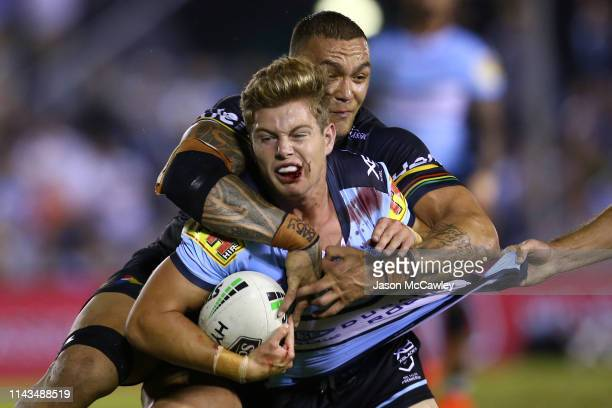 Blayke Brailey of the Sharks is tackled by James Fisher-Harris of the Panthers during the round 6 NRL rugby league match at PointsBet Stadium on...
