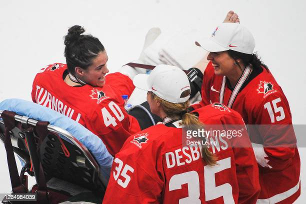 Blayre Turnbull of Canada comes out on a stretcher to celebrate her team's gold medal win over the United Sates with teammates Ann-Renee Desbiens and...