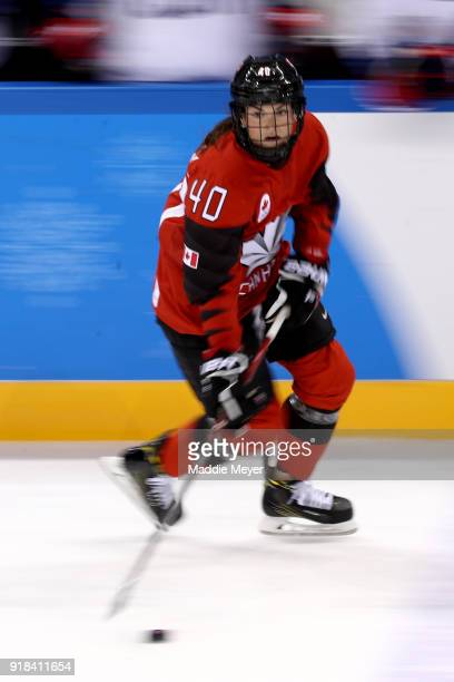 Blayre Turnbull of Canada controls the puck against United States during the Women's Ice Hockey Preliminary Round Group A game on day six of the...