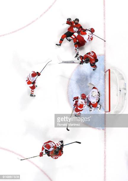 Blayre Turnbull of Canada falls on Yekaterina Lobova of Olympic Athlete from Russia in the first period during the Women's Ice Hockey Preliminary...