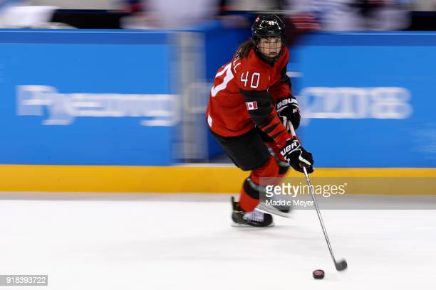 Blayre Turnbull of Canada handles the puck against the United States during the Women's Ice Hockey Preliminary Round Group A game on day six of the...