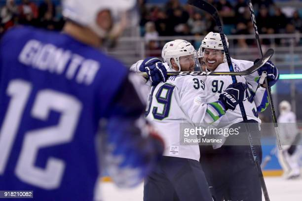 Blaz Gregorc of Slovenia celebrates with his teammates after scoring a goal against Ryan Zapolski of the United States in the third period during the...