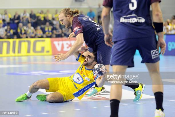Blaz Janc Henrik Mollgaard during the EHF Men's Champions League Game between PGE Vive Kielce and PSG Handball on November 26 2017 in Kielce Poland