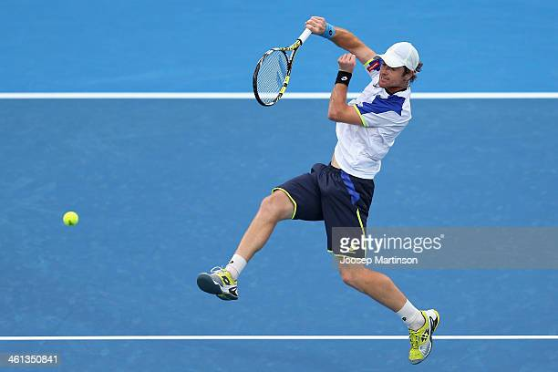 Blaz Kavcic of Slovenia plays a forehand in his quarter final match against Bernard Tomic of Australia during day four of the 2014 Sydney...