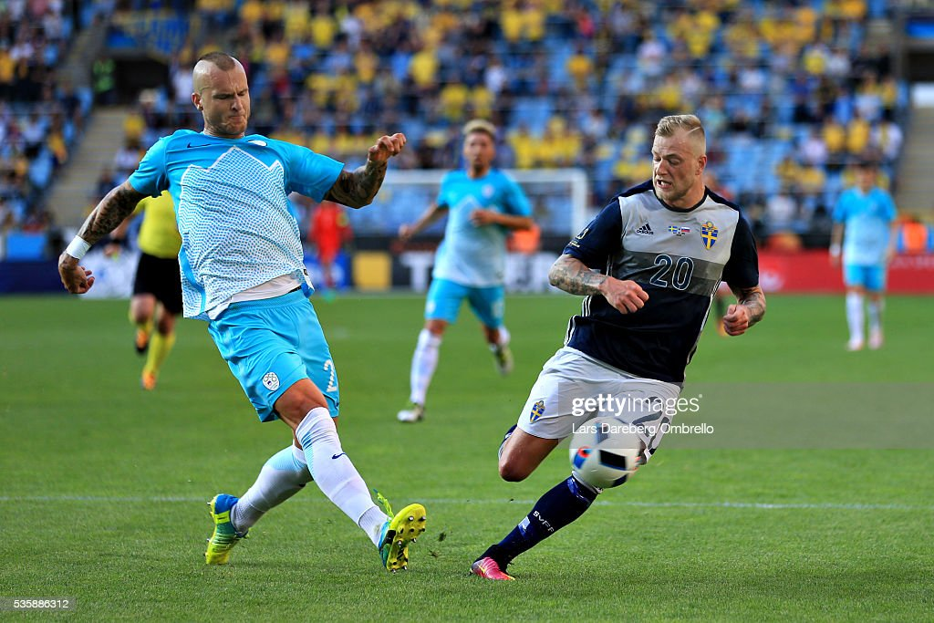 Blaz Vrhovec of Slovenia and John Guidetti of Sweden during the international friendly match between Sweden and Slovenia on May 30, 2016 in Malmo, Sweden.
