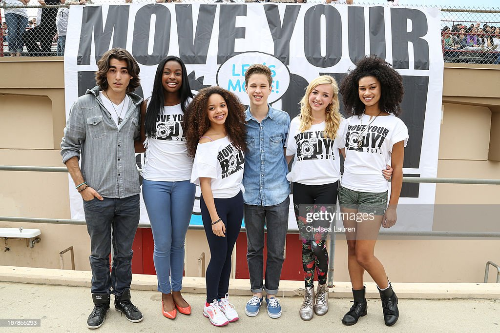 DJ Blaze, actress Coco Jones, actress Jadagrace, singer Ryan Beatty, actress Peyton List and actress Michaela Blanks attend the WAT-AAH! Foundation Move Your Body 2013 Flash Workout at Hollywood High School on May 1, 2013 in Los Angeles, California.
