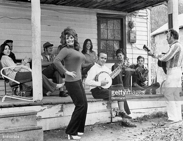 Blaze Starr well known stripper and her Possum Hollow Symphony in full swing at her mother's home just before returning to Baltimore to open up her...