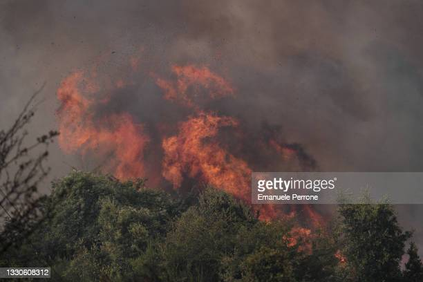 Blaze that has destroyed thousands of hectares of land continues to burn on July 25, 2021 in the province of Oristano in Sardinia, Italy. Hundreds of...