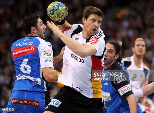 Blazenko Lackovic and Bertrand Gille of Hamburg and Martin Strobel of Germany compete for the ball during the charity match for benefit of Oleg...