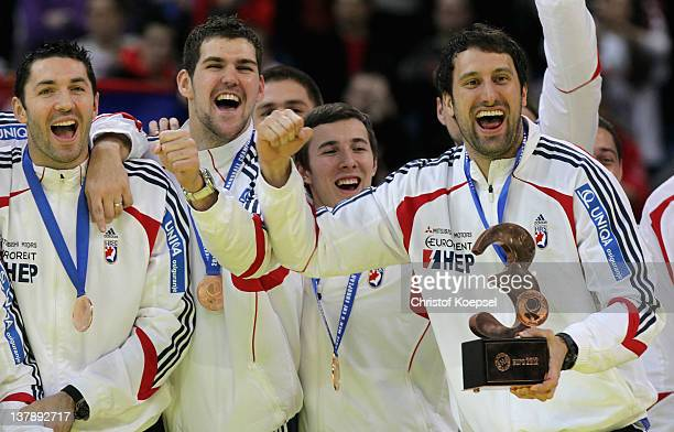 Blazenko Lackovic Jakov Gojun and Igor Vori of Croatia celebrate the third place on the podium after the Men's European Handball Championship final...
