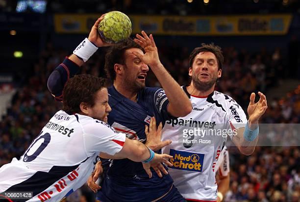 Blazenko Lackovic of Hamburg is blocked by Thomas Mogensen of Flensburg during the Toyota Handball Bundesliga match between HSV Hamburg and SG...