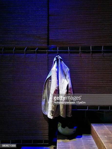 blazer hanging on hook above helmet in sampo hall - blazer jacket stock photos and pictures