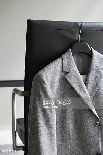 Blazer hanging on office chair