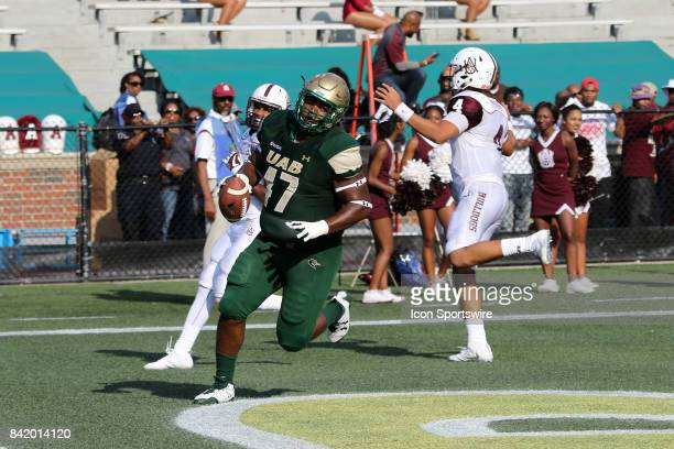 Blazers defensive lineman Anthony Rush scores a touchdown on an interception return in the game between the UAB Blazers and the Alabama AM Bulldogs...