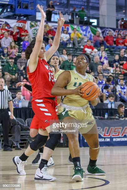 Blazers forward Katelynn Thomas is guarded by Western Kentucky Lady Toppers center Raneem Elgedawy during the Conference USA Women's Basketball...