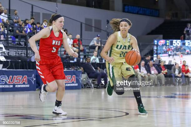 Blazers guard Deanna Kuzmanic drives around Western Kentucky Lady Toppers guard Whitney Creech during the Conference USA Women's Basketball...
