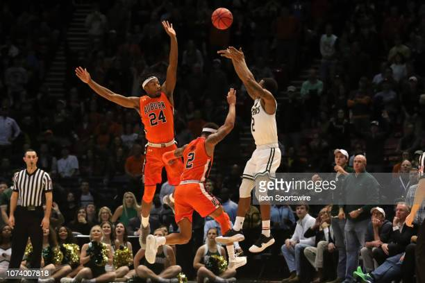 Blazers guard Jeremiah Bell shoots a three pointer over Auburn Tigers forward Anfernee McLemore and Auburn Tigers guard Bryce Brown to force overtime...