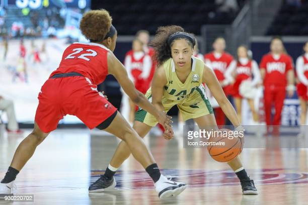 Blazers guard Miyah Barnes is guarded by Western Kentucky Lady Toppers guard Sherry Porter during the Conference USA Women's Basketball Championship...