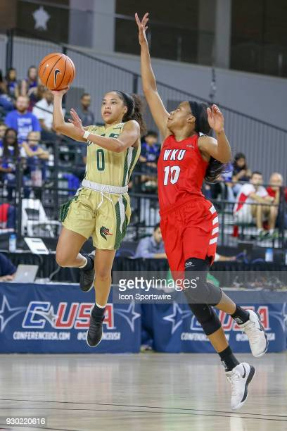 Blazers guard Miyah Barnes throws up a shot at the end of the 3rd quarter with Western Kentucky Lady Toppers forward Tashia Brown defending during...