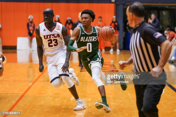 Blazers guard Tyreek ScottGrayson drives past TexasSan Antonio Roadrunners forward Atem Bior during the NCAA game between the UAB Blazers and the...