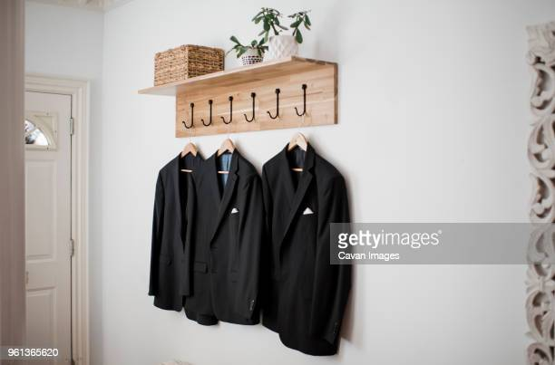 Blazers hanging on wall at home