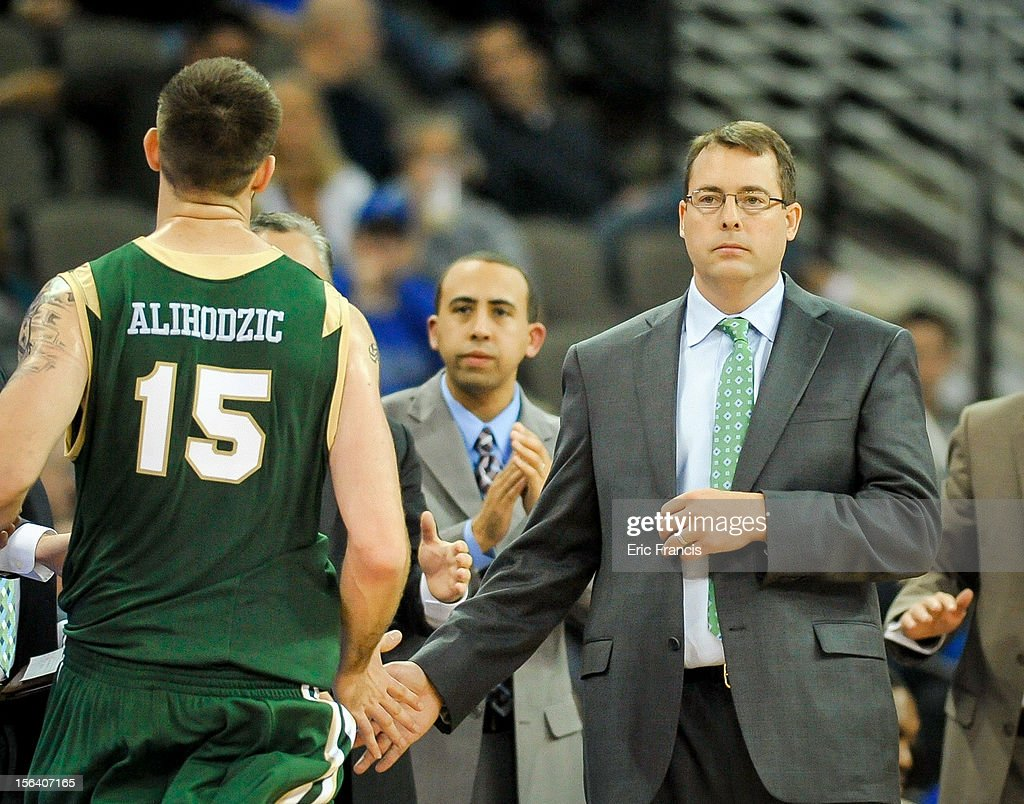 UAB Blazers head coach Jerod Haase congratulates Fahro Alihodzic #15 of the UAB Blazers after coming off the floor against the Creighton Bluejays during their game at CenturyLink Center on November 14, 2012 in Omaha, Nebraska.