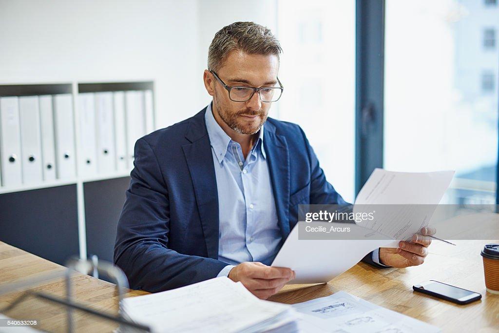 Blazing through his paperwork : Stock Photo