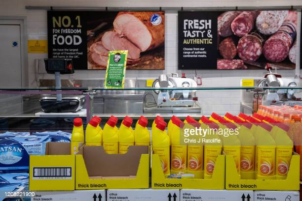 Bleach is stocked in front of a closed delicatessen counter in a Sainsburys supermarket as the outbreak of coronavirus intensifies on March 25, 2020...