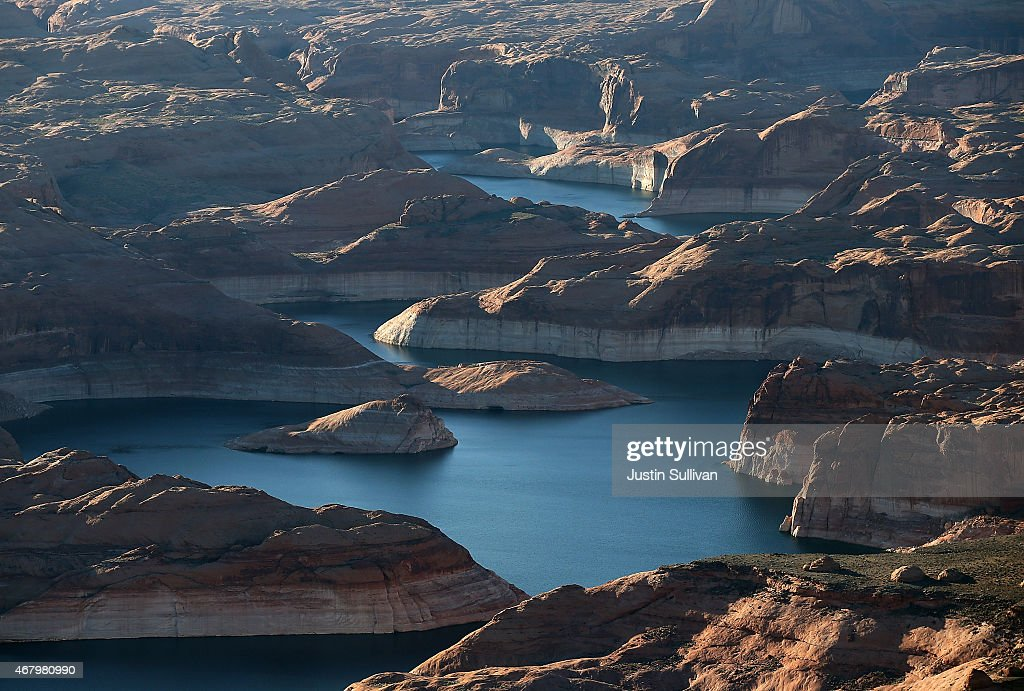A bleached 'bathtub ring' is visible on the rocky banks of Lake Powell on March 28, 2015 in Lake Powell, Utah. As severe drought grips parts of the Western United States, a below average flow of water is expected to enter Lake Powell and Lake Mead, the two biggest reservoirs of the Colorado River Basin. Lake Powell is currently at 45 percent of capacity, a recent study predicts water elevation there to be above 3,575 by September. The Colorado River Basin supplies water to 40 million people in seven western states.