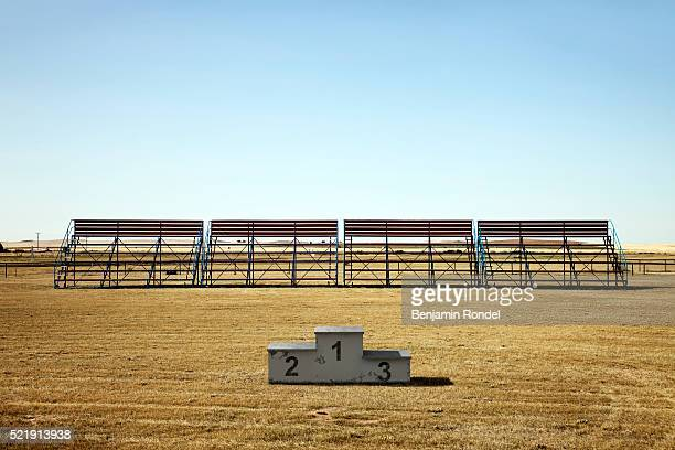 bleachers and medals podium in a sports field - winners podium stock pictures, royalty-free photos & images