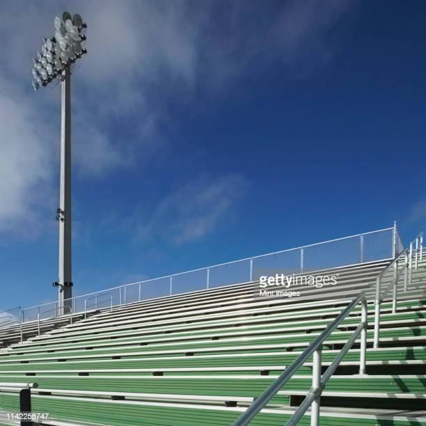 bleachers at a sports field - high school football stock pictures, royalty-free photos & images