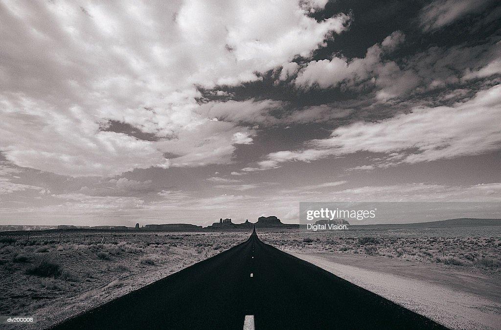 Bleak horizon highway running down center : Stock Photo