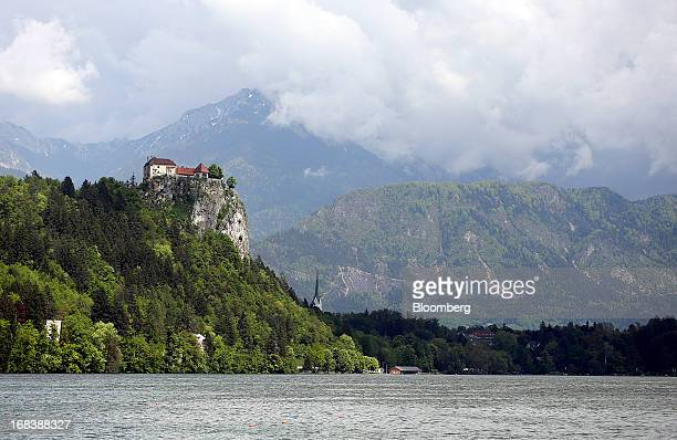 Bled castle is seen beneath the Julian Alps on the shore of Lake Bled in Bled Slovenia on Wednesday May 8 2013 Slovenia's recession will stretch into...